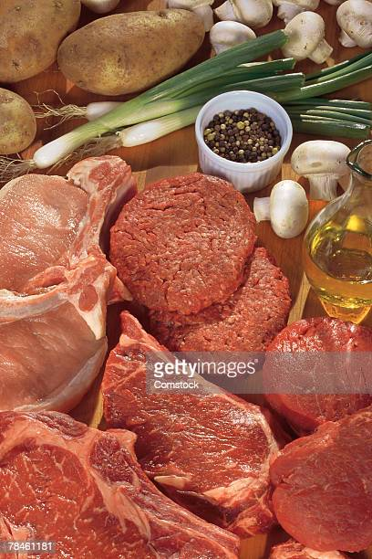 Assorted raw meat and ingredients for cooking