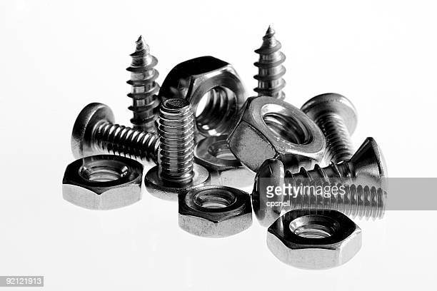 assorted screws and nuts - nut fastener stock photos and pictures