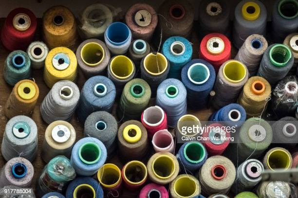 Assorted spools of sewing thread