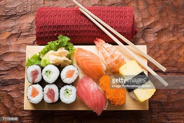 Assorted sushi on sushi board