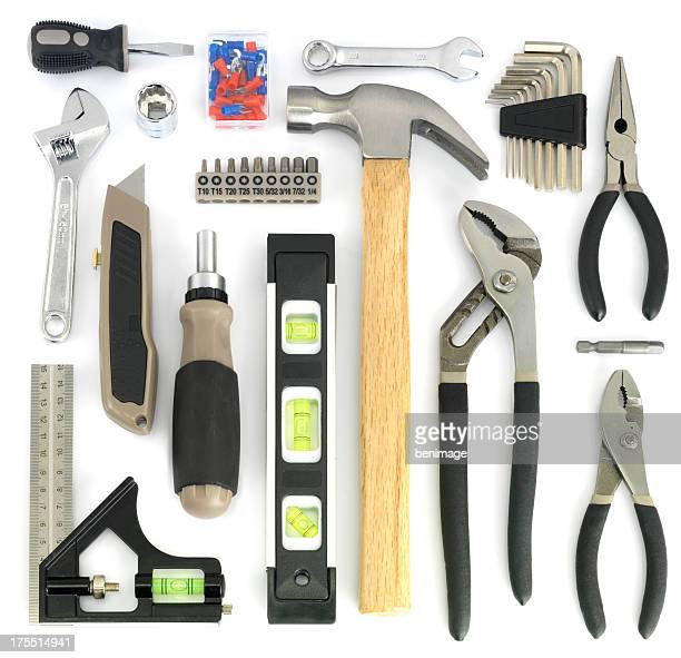 Assorted tools arranged on white background