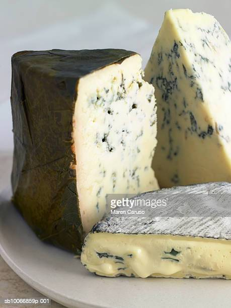 Assortment of blue cheeses on plate