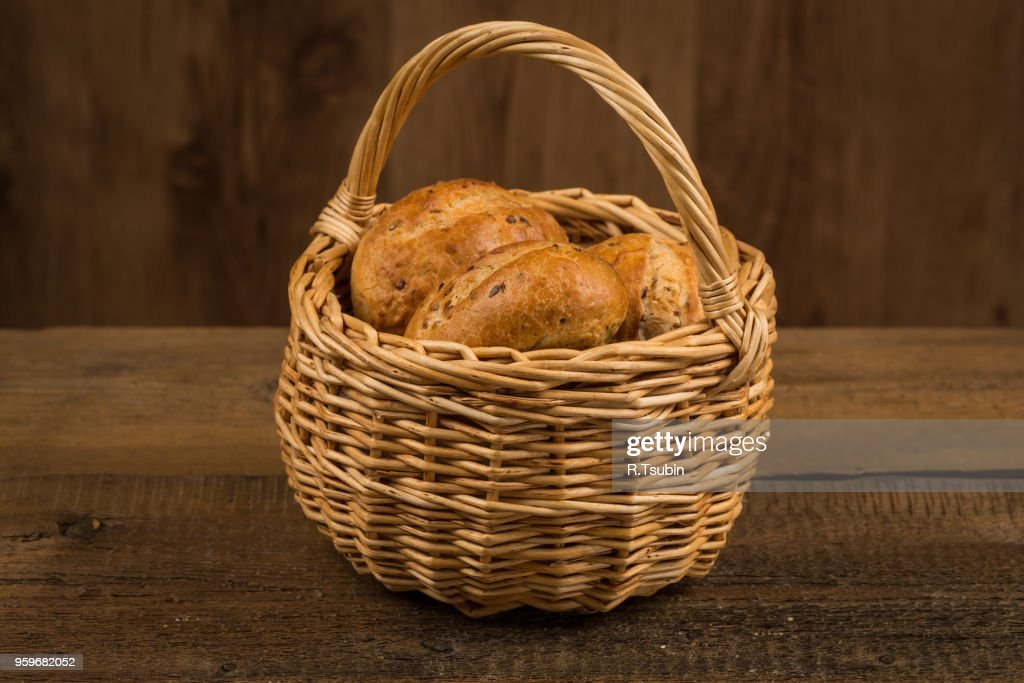assortment of bread, baking products on wooden table : Stock-Foto