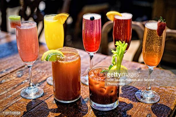 assortment of brunch cocktails, including bloody mary and mimosas - mimosa stock pictures, royalty-free photos & images
