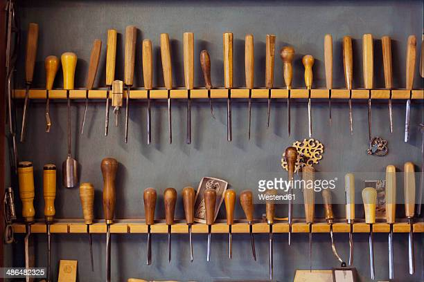 Assortment of chisels in a volin maker's workshop
