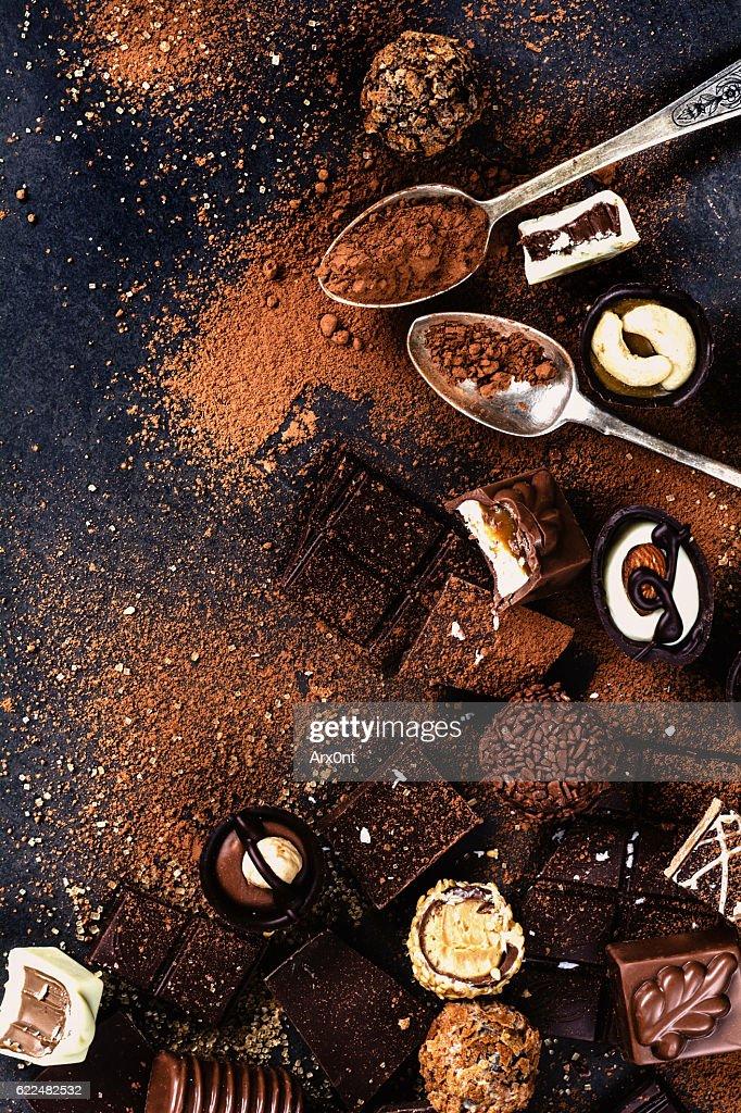 Assortment of chocolates, chocolate bars, truffles and pralines : Stock Photo