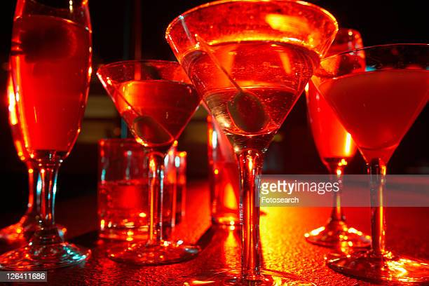 Assortment of cocktails on table (close-up, low angle view)