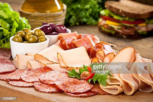 assortment of cold appetizer displayed on rustic wood table - delicatessen stock pictures, royalty-free photos & images