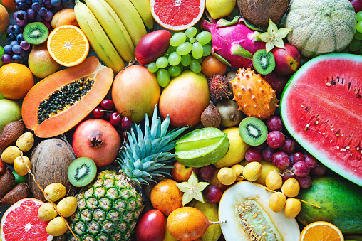 Assortment of colorful ripe tropical fruits. Top view 995518546