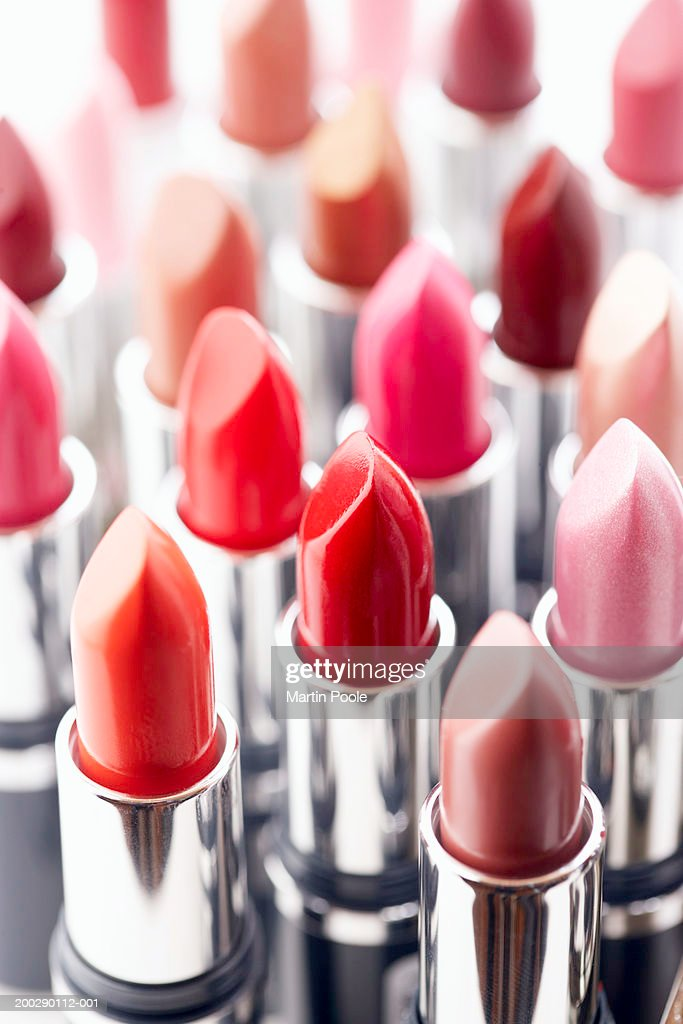 Assortment of coloured lipsticks, close-up : Stock Photo