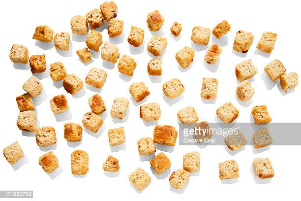 assortment of croutons - crouton stock photos and pictures