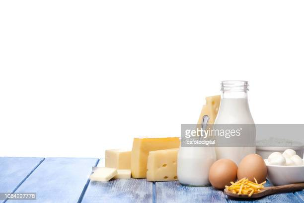 assortment of dairy products shot on blue striped table against blue striped table - dairy stock pictures, royalty-free photos & images