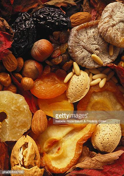 assortment of dried fruits and nuts, full frame - dörrpflaume stock-fotos und bilder