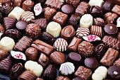 Assortment of fine chocolate candies, white, dark, and milk chocolate. Sweets background.