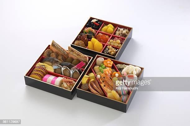 Assortment of foods in bento boxes, studio shot