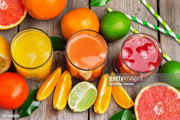 assortment of fresh juices - grapefruit red stock pictures, royalty-free photos & images