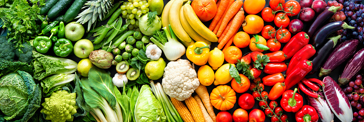 Assortment of fresh organic fruits and vegetables in rainbow colors 1203599952