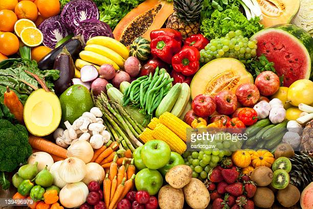assortment of fruits and vegetables background. - heap stock pictures, royalty-free photos & images