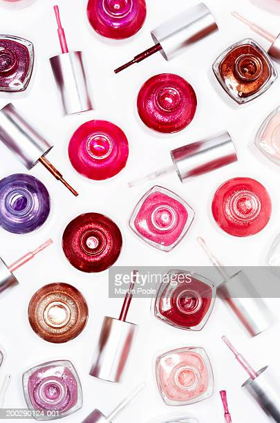 assortment of nail varnish bottles and lids, elevated view - マニキュア液 ストックフォトと画像