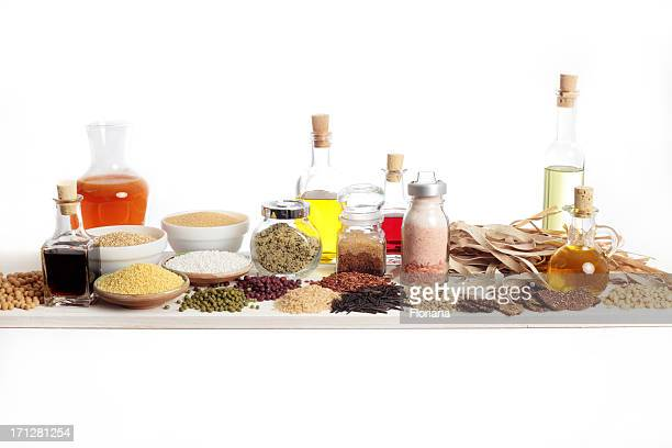 Assortment of organic spices and foods on white background