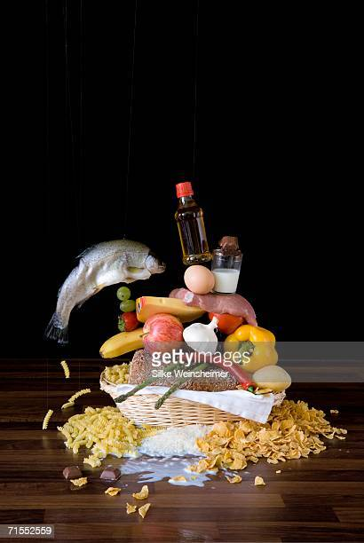 Assortment of raw food stacked up in basket on table