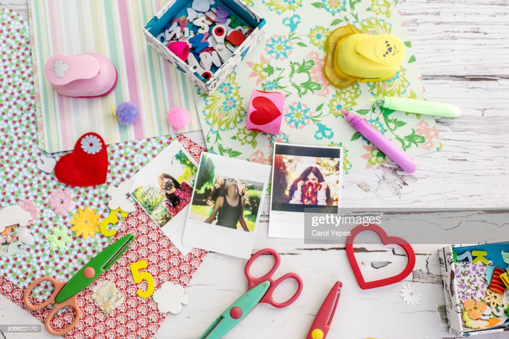 'Assortment of scrapbooking tools including colored paper, pens, and scissors.Click below for more of my scrapbooking and arts and crafts images: : Stock Photo