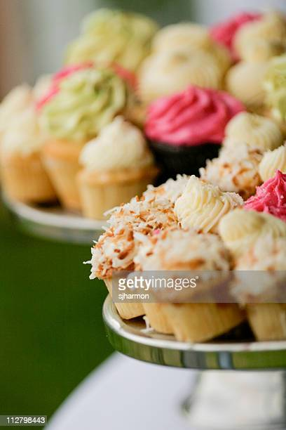 Assortment of small colorfull cupcakes at reception