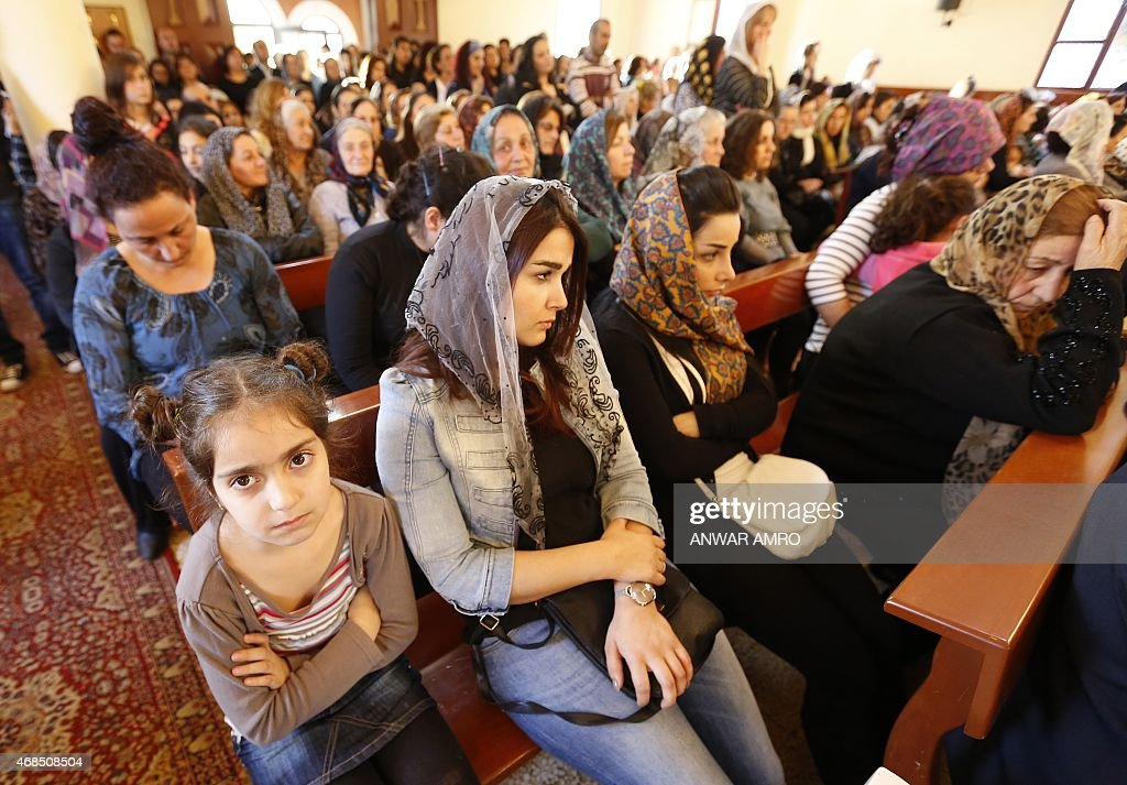 assyrian-christians-who-had-fled-the-unrest-in-syria-attend-a-mass-at-picture-id468508504