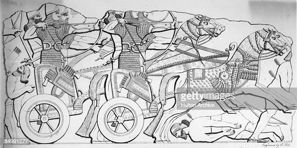 Assyrian warriors fighting from chariots, circa 1300 BC. An engraving by W. Holl from a bas relief from the ancient city of Nimrud, in modern Iraq.