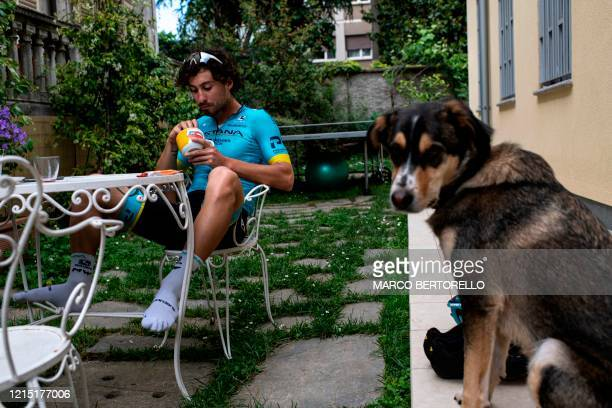 Astana cycling team Italian rider Fabio Felline eats after exercising at home on May 19 in Turin, Piedmont, as the country eases its lockdown aimed...