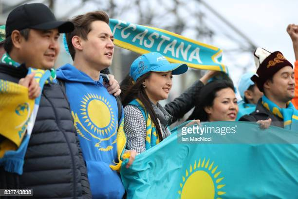 Astana fans are seen prior to the UEFA Champions League Qualifying PlayOffs Round First Leg match between Celtic FC and FK Astana at Celtic Park on...