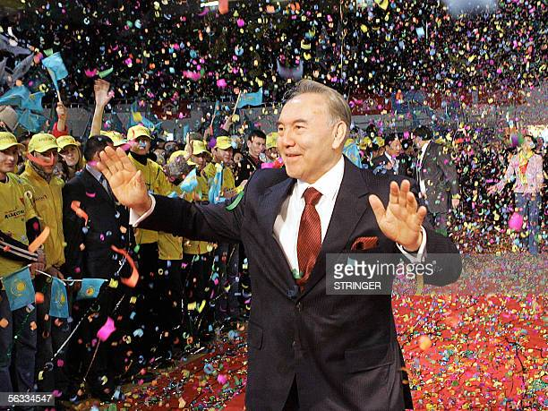 Kazakh President Nursultan Nazarbayev waves to supporters after his landslide victory in 04 December's presidential election was officially announced...