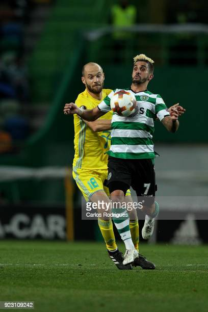 Astana midfielder Ivan Maevski from Bielorussia vies with Sporting CP forward Ruben Ribeiro from Portugal for the ball possession during UEFA Europa...
