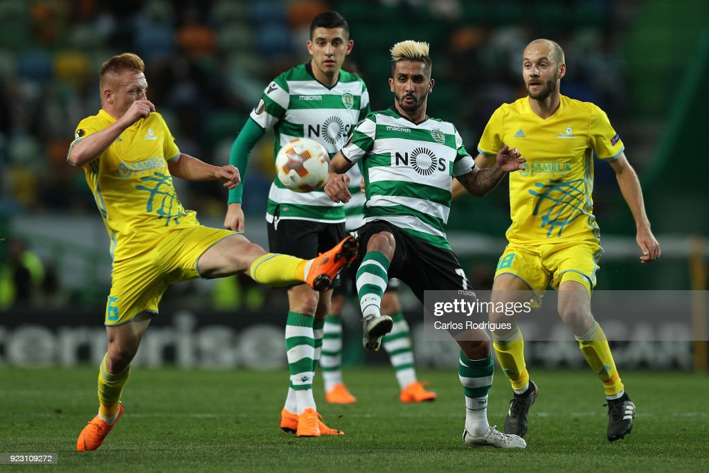 Astana midfielder Laszlo Tleinheisler from Hungary (L) vies with Sporting CP forward Ruben Ribeiro from Portugal (R) for the ball possession during UEFA Europa League Round of 32 match between Sporting Lisbon and FC Astana at the Estadio Jose Alvalade on February 22, 2018 in Lisbon, Portugal.