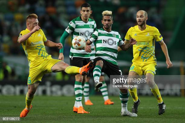 Astana midfielder Laszlo Tleinheisler from Hungary vies with Sporting CP forward Ruben Ribeiro from Portugal for the ball possession during UEFA...