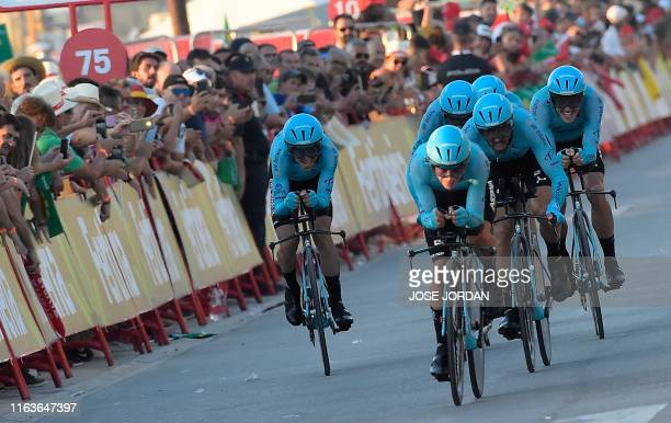 Astana Pro Team cyclists compete during the first stage of the 2019 La Vuelta cycling tour of Spain a 134 km race against the clock between Salinas...