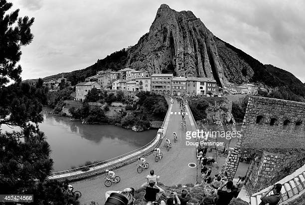 Astana Pro Team leads the peloton over La Durance River as they defend the yellow jersey of Vincenzo Nibali of Italy and the Astana Pro Team during...