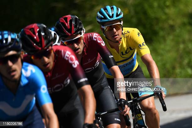 Astana Pro Team rider Denmark's Jakob Fuglsang, wearing the overall leader's yellow jersey, rides during the eighth and last stage of the 71st...