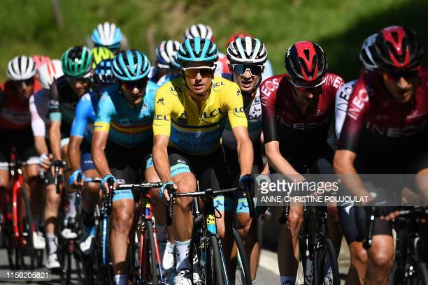 Astana Pro Team rider Denmark's Jakob Fuglsang, wearing the overall leader's yellow jersey, rides in the pack during the eighth and last stage of the...