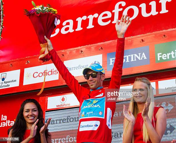 Astana Pro Team's Italian rider Vincenzo Nibali celebrates retaining the red jersey on the podium of the 12th stage of the 68th edition of La Vuelta...