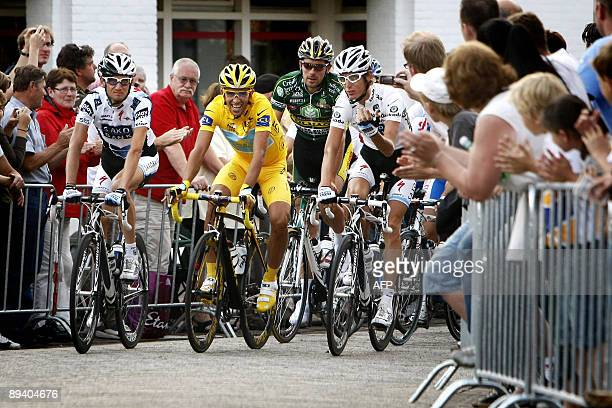 Astana team rider and Tour de France 2009 winner Alberto Contador of Spain rides with Andy Schleck and Frank Schleck of Luxembourg during the 30th...