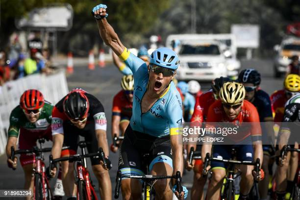 Astana team's Danish rider Magnus Cort Nielsen celebrates as he crosses the finish line to win the fourth stage of the cycling Tour of Oman between...
