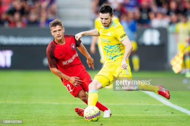 Astana's Antonio Rukavina and Midtjylland's Mikkel Duelund vie for the ball during the UEFA Champions League second round second leg qualifying...