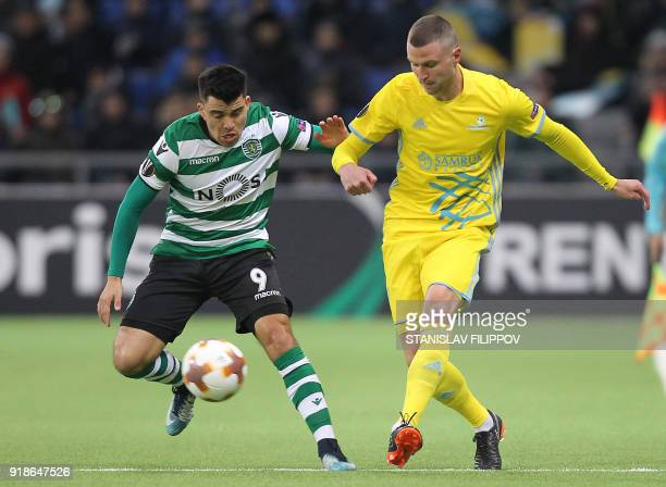 Astana's Bosnian defender Marin Anicic vies with Sporting's Argentinian forward Marcos Acuna during the Europa League Round of 32 first leg football...