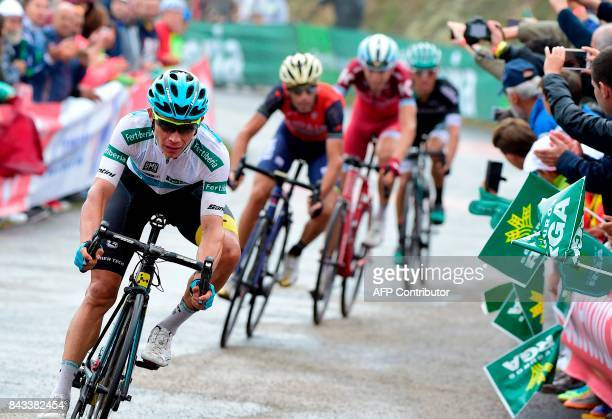 Astana's Colombian cyclist Miguel Angel Lopez Moreno crosses the finish line of the 17th stage of the 72nd edition of La Vuelta Tour of Spain cycling...