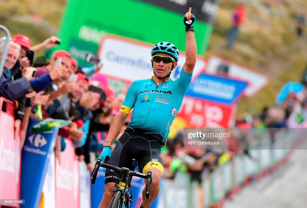Astana's Colombian Miguel Angel Lopez celebrates while crossing the finish line after winning the 11th stage during the 72nd edition of 'La Vuelta' Tour of Spain cycling race, a 187,50 km route between Lorca to Calar Alto on August 30, 2017. /