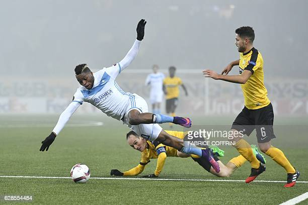 Astana's Congolese forward Junior Kabananga falls above Young Boys' Swiss defender Steve von Bergen during the UEFA Europa League group stage...