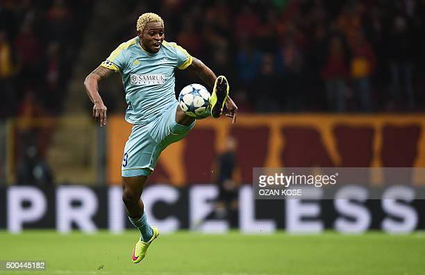 Astana's Congolese forward Junior Kabananga jumps for the ball during the UEFA Champions League Group C football match between Galatasaray AS and FC...