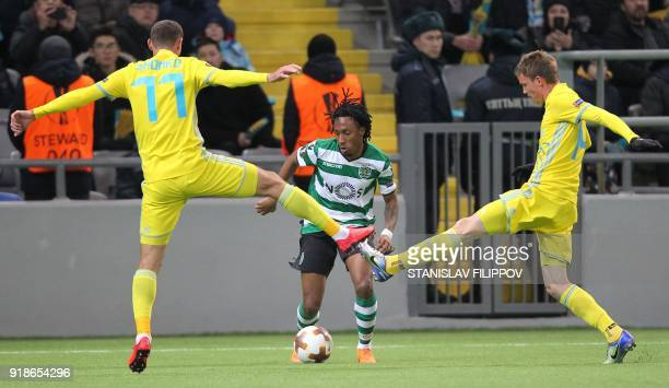 Astana's defender Dmitri Shomko and Astana's Croatian midfielder Marin Tomasov defend against Sporting's forward Gelson Martins during the Europa...