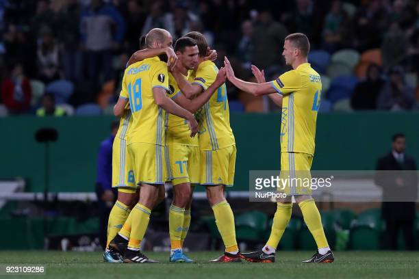 Astanas defender Dmitriy Shomko celebrates with teammates after scoring during the UEFA Europa League round of 32 second leg football match between...